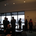 Guests enjoying food and networking before event.